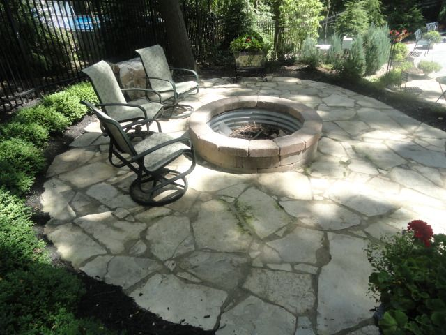 tumbled paver fire pit blends in great with this flagstone patio in brighton michigan  design