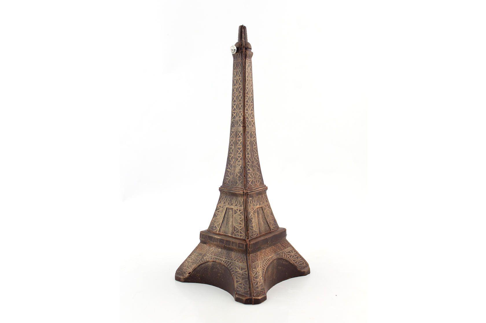 Grande tour Eiffel entièrement en chocolat. Emballage papier cadeau. Hauteur : 32cm - Largeur : 12cm. Poids : 250gr.