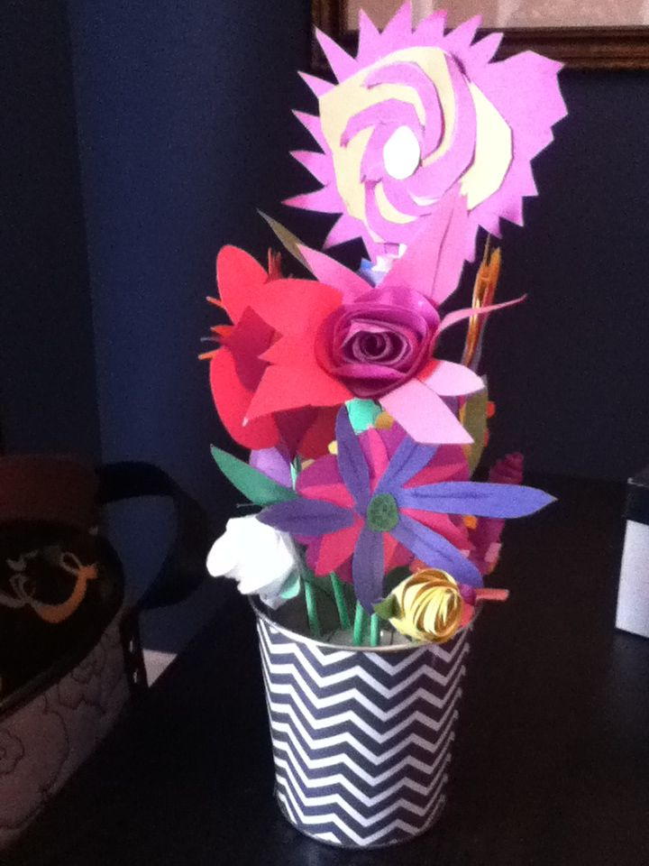 Flowers made from construction paper by elementary students and then assembled in pots.