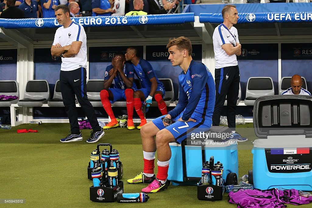 Antoine Griezmann of France and his team-mates look dejected at the end of the UEFA Euro 2016 Final match between Portugal and France at Stade de France on July 10, 2016 in Paris, France.