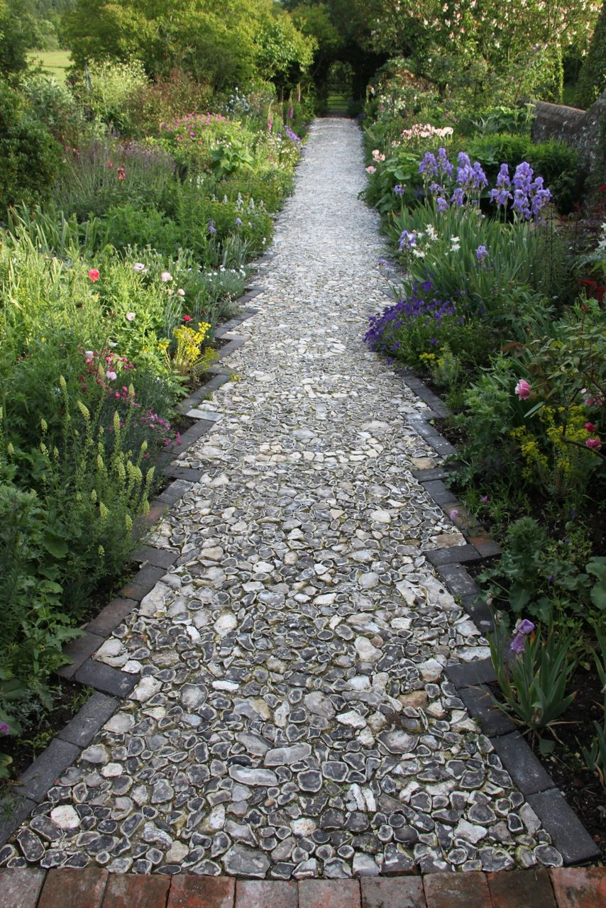 The flint walkway is finished at my brother's farm! This was done completely by hand (from splitting flint stones to the edging and placing of the stones). Cannot wait to see them in person..