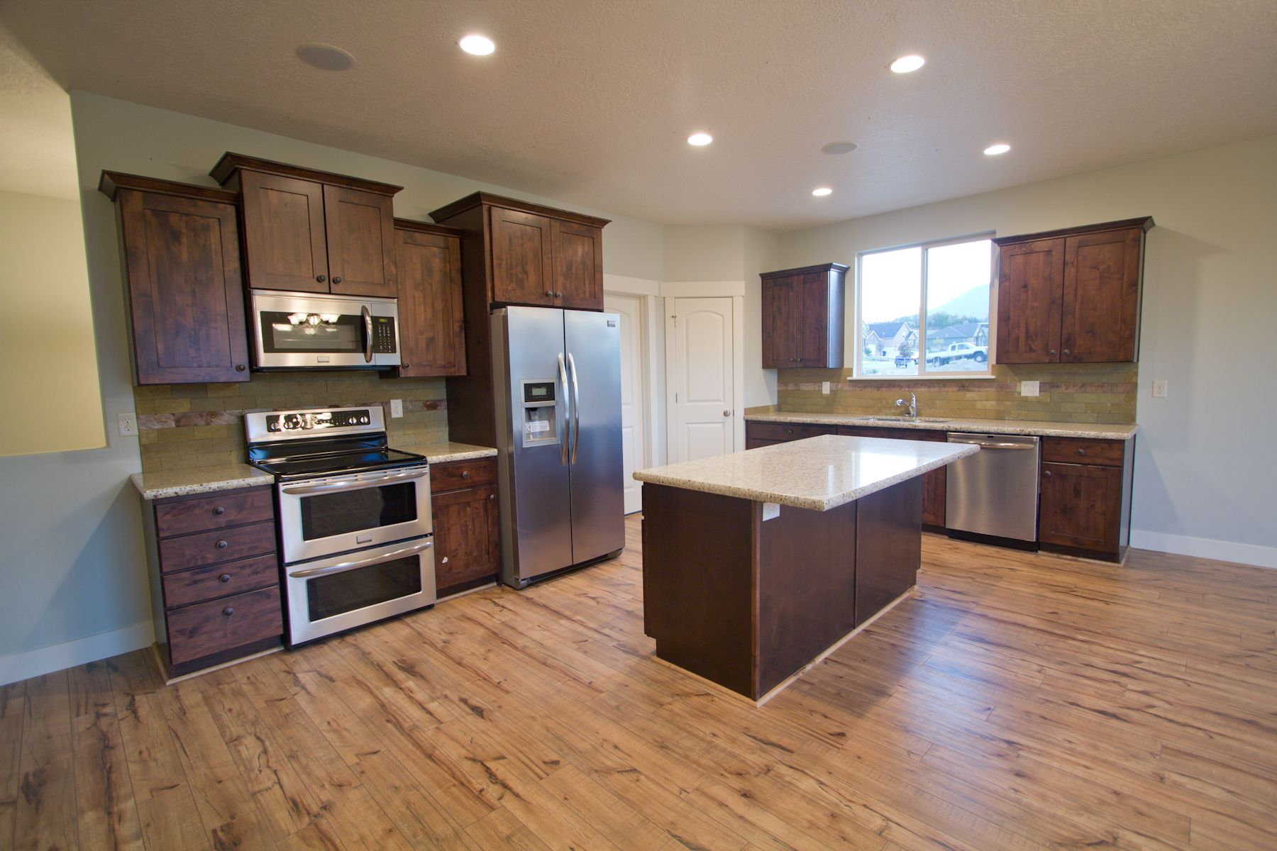 Solid Wood Floor In Kitchen Contemporary Craftsman Espresso Cabinets With White Porcelain Top
