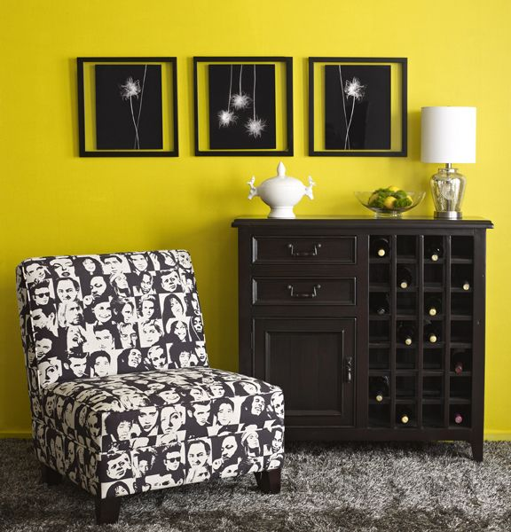 Black and Yellow. Icon chair\'s fabric is covered in famous portraits ...