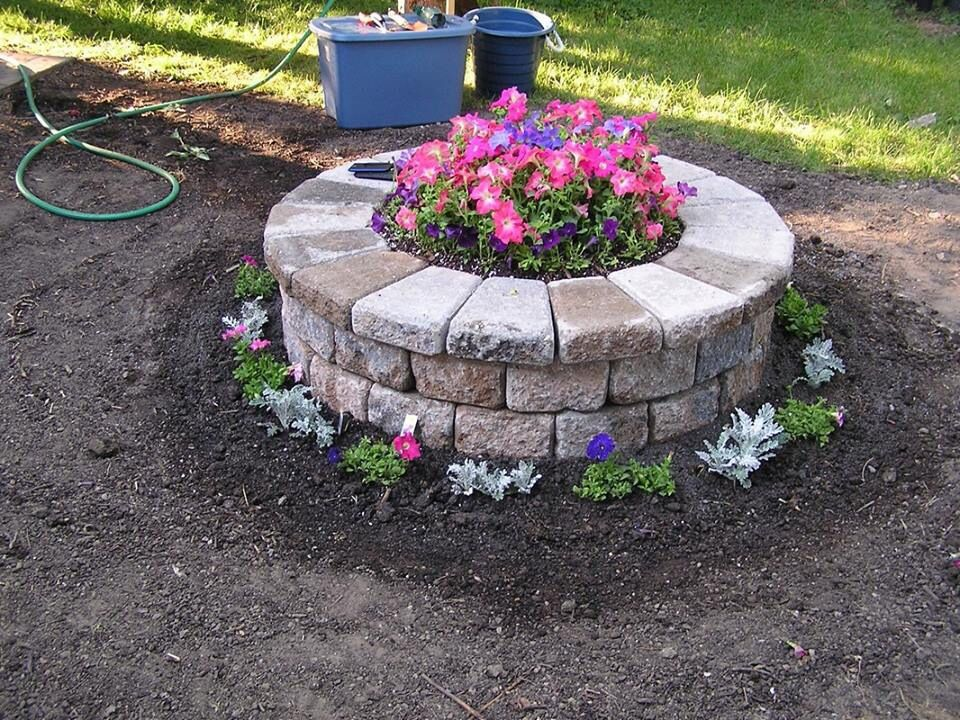 Raised round flower bed outside pinterest gardens for Circular raised garden bed ideas