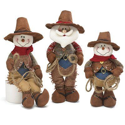 "Western Cowboy Snowman & Santa Plush Decoration Set of 3 Set includes two snowmen and one Santa.21""H X 5""W X 2 1/2""D Sitting.18""H X 7 1/2""W X 3 1/2""D.13""H X 8""W X 3""D     Image courtesy of Burton"