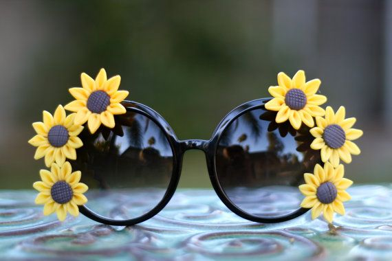 Black round framed sunflower boho chic sunglasses by TheNenaMoon  My tax return is coming in soon and I think I may spoil myself a little with these pretty babies.