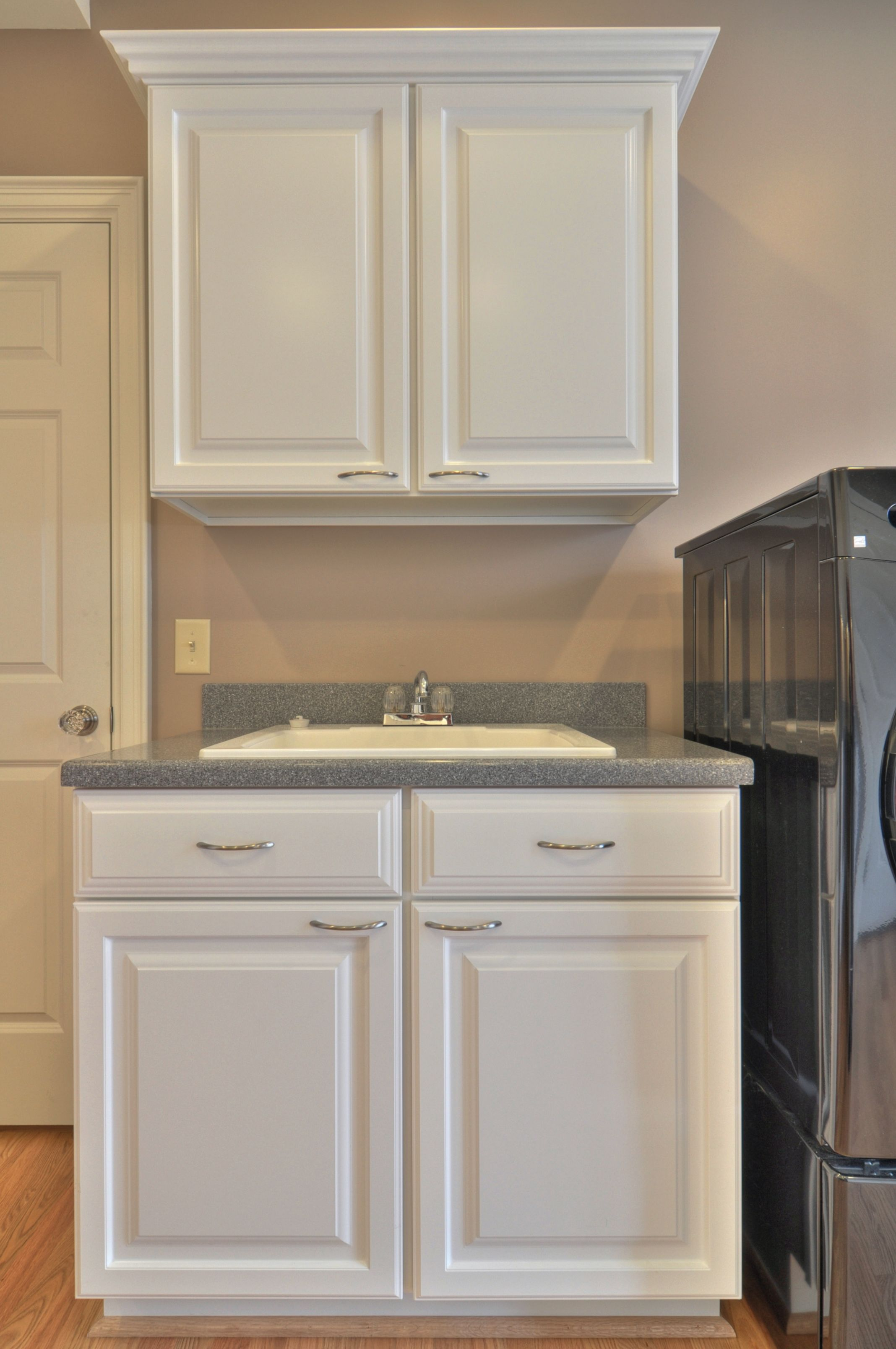 Built In Laundry Room Utility Sink. Thermal Foil Cabinets With Solid  Surface Countertops. Gives Extra Storage And Organization For The Laundry  Room.