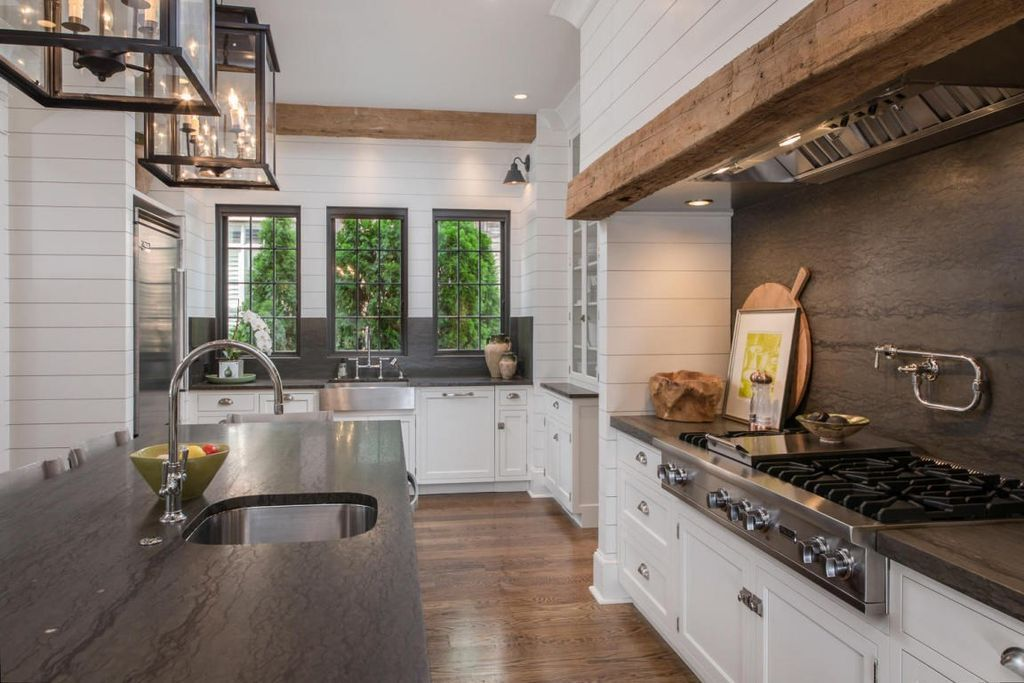 Traditional Kitchen With Farmhouse Sink, Complex Marble, Kitchen Island,  Flat Panel Cabinets, Cygnus Granite Countertop