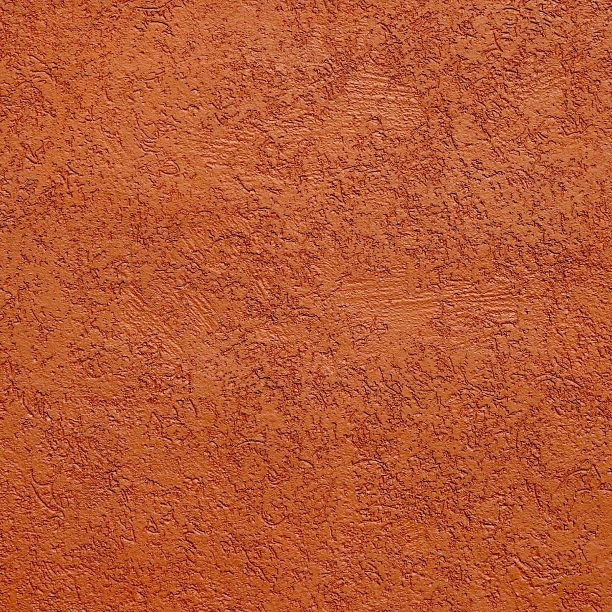 Contrast Between Stone And Plaster Finish: Rust Colored Textured Stucco Wall.
