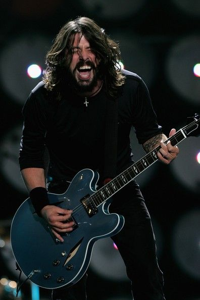 Dave Grohl of American rock band Foo Fighters performs on stage during the Live Earth concert held at Wembley Stadium on July 7, 2007 in London. Live Earth is a 24-hour, 7-continent concert series taking place on 7/7/07, bringing together more than 100 music artists and 2 billion people to trigger a global movement to solve the climate crisis.