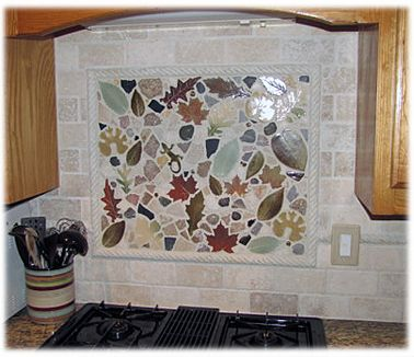 A Small Order Of Leaf Tiles Mixed With Rocks Can Create A Unique Stove Top Backsplash