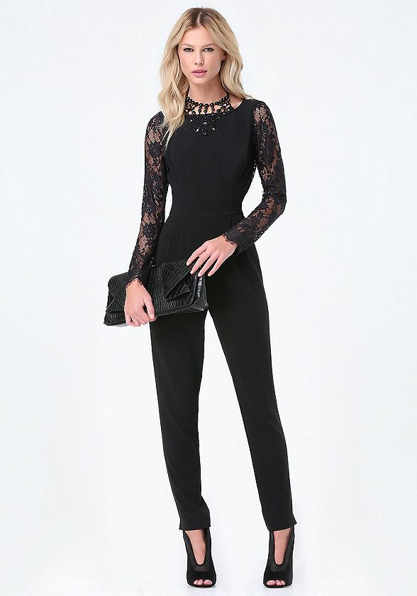 Posh crepe jumpsuit detailed by lace sleeves, a curve-defining inset waist and elegant lace flyaway back that reveals a little skin. Front pleats and hem vents finish the look. Back button-loop closures. Hidden back hook-and-eye and zip closure. Partially lined.