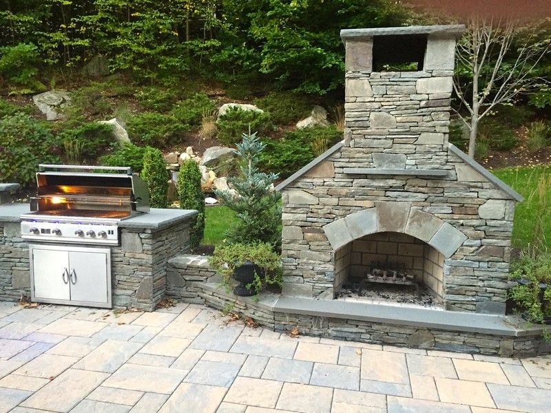 36 Standard Outdoor Fireplace With Natural Stone Veneer Sits Alongside A Tlr 38 Stainless Steel Gr Outdoor Stone Fireplaces Outdoor Fireplace Patio Fireplace