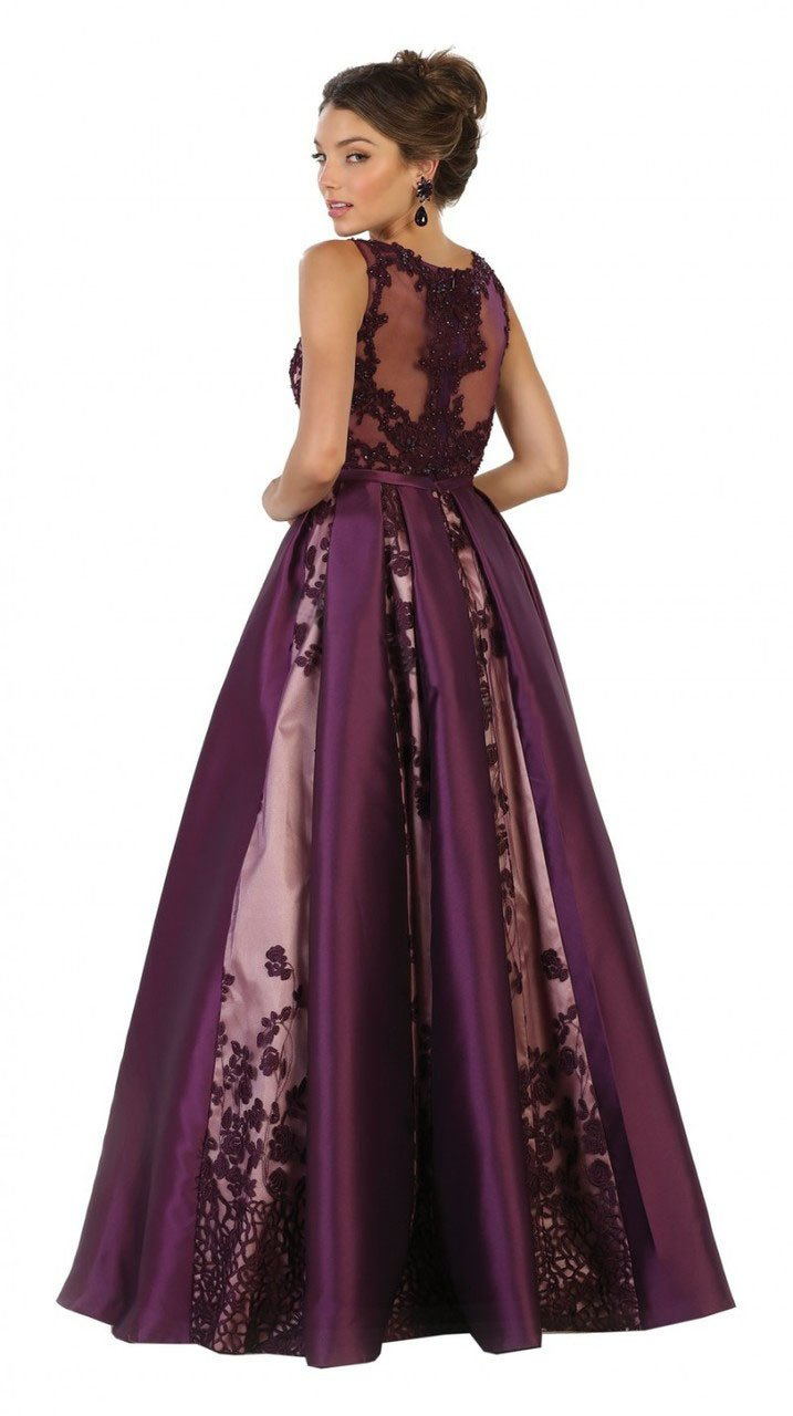c8e7ba1b471 This gorgeous long prom dress features an illusion neckline. A trim fit  details bust and