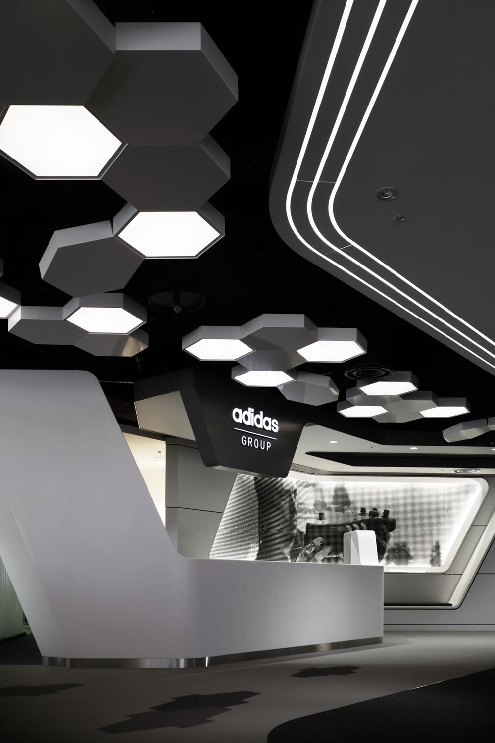 Adidas japan headquarters office office design for Office design japan