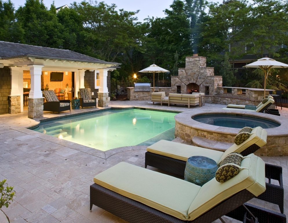 This outdoor space has it all! Pool, hot tub, fireplace and more ...
