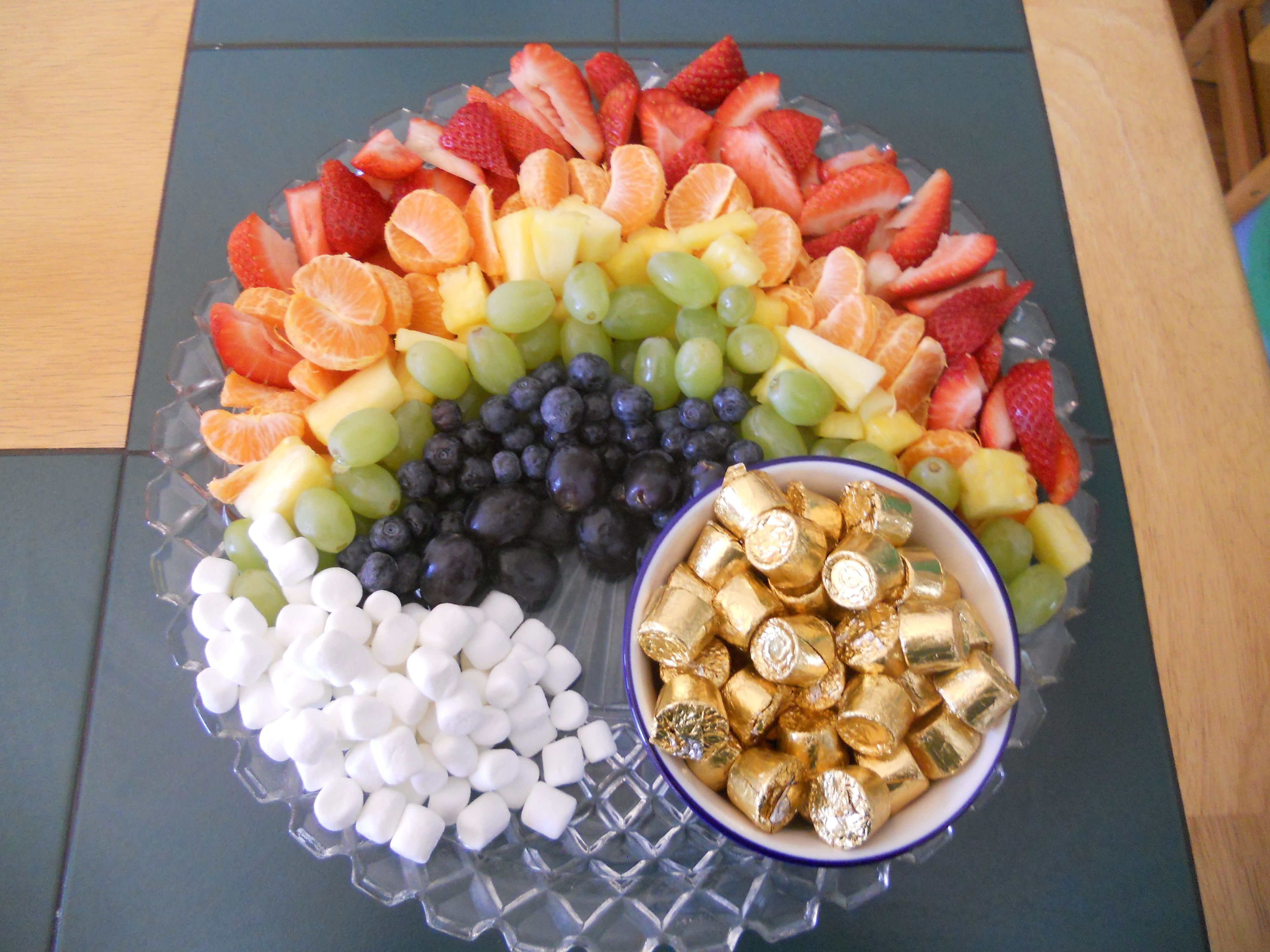 I made this cute rainbow fruit tray for my son's birthday party that was on St. Pat's day.  Thanks Pinterest!