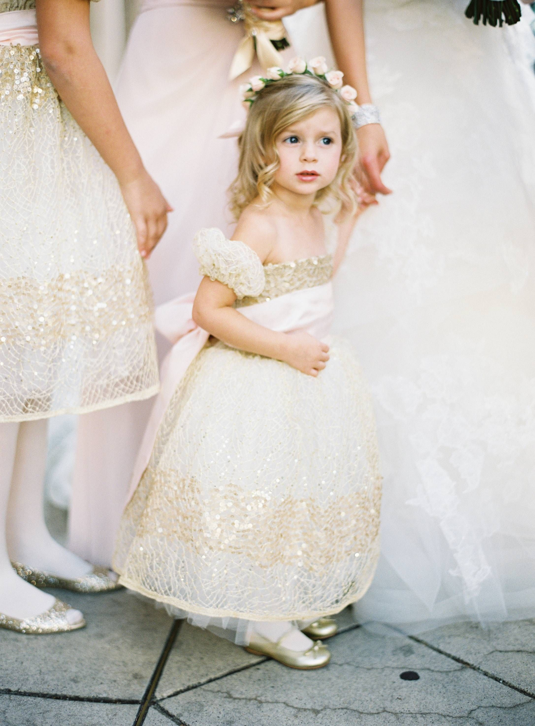 549cb8a43c7 Flower girls wore beautiful ball gowns adorned with gold sequins and  intricate embroidery. The youngest