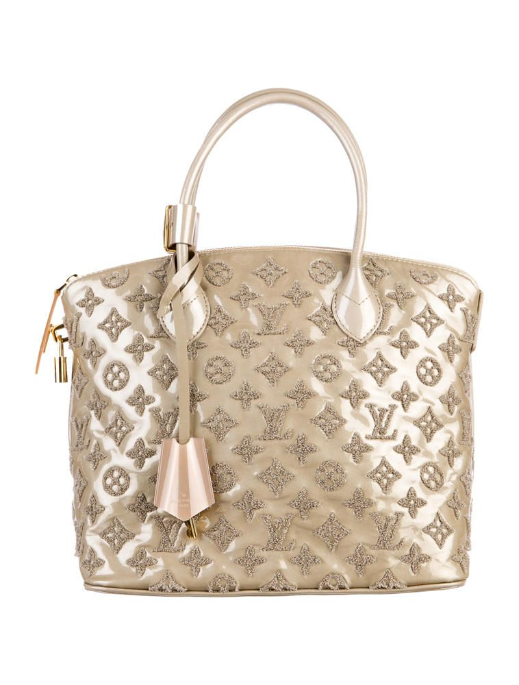 175c3d08d5b3d From the Fall Winter 2011 collection. Taupe patent lambskin Louis Vuitton  Fascination Lockit Bag