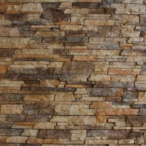 interior stone walls of faux stacked stone wall