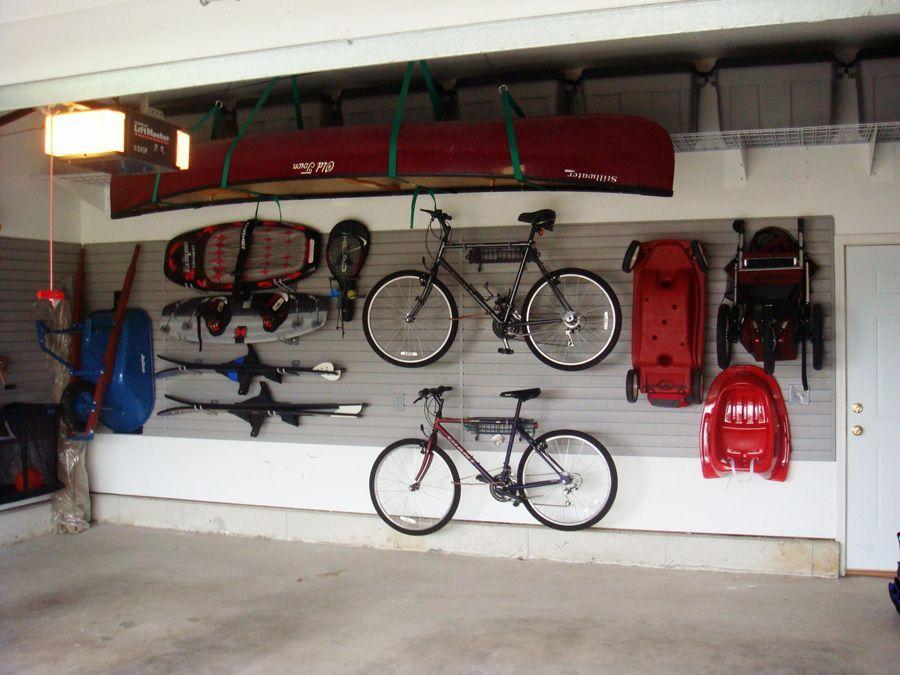 Garage Storage Systems For Neat And Tidy Garage Mountain Bicycle White Wall Red Cano Cement Floor Bike Garag Garage Organization Bicycle Garage Garage Storage