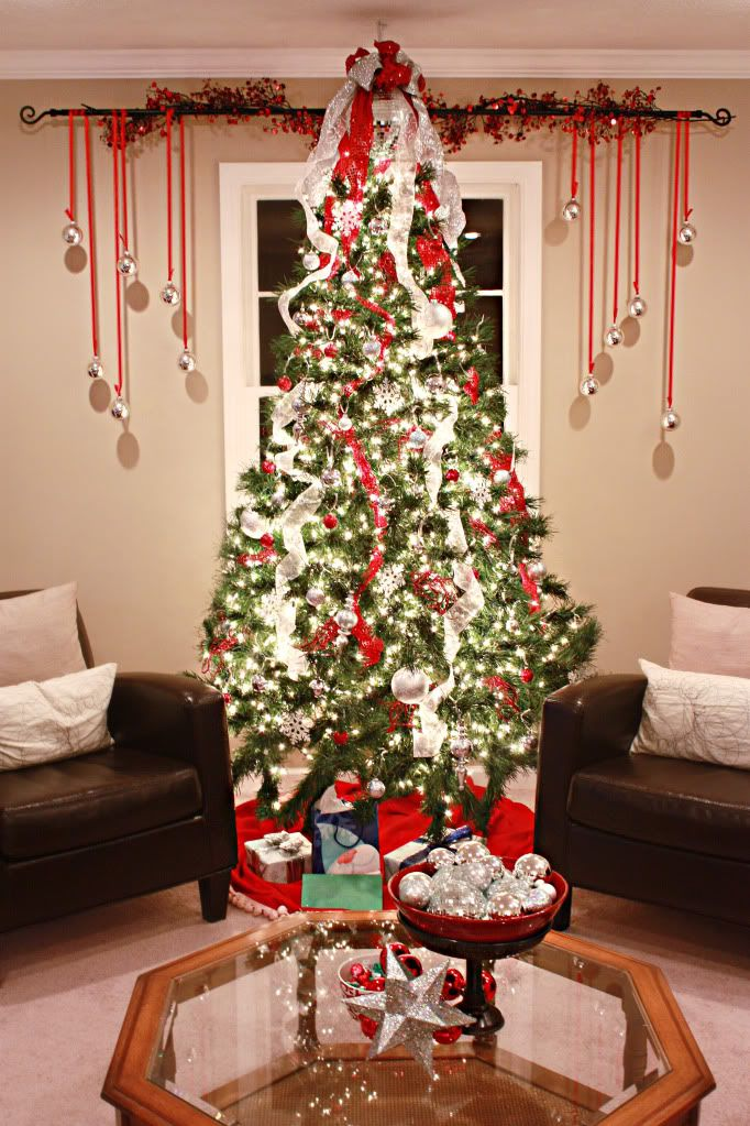 i know its august but i love the ribbons and ornaments hanging behind the tree - Red And Silver Christmas Tree