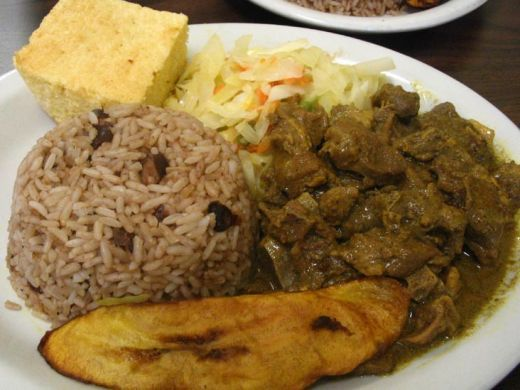 curried goat rice n red peas 'tun' cornmeal fried