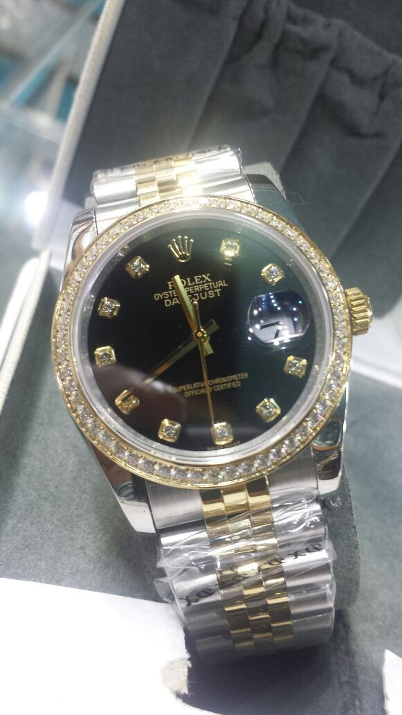 0c13a879486 Rolex Oyster Perpetual Date Display Golden Black Watch Price In Pakistan.  http