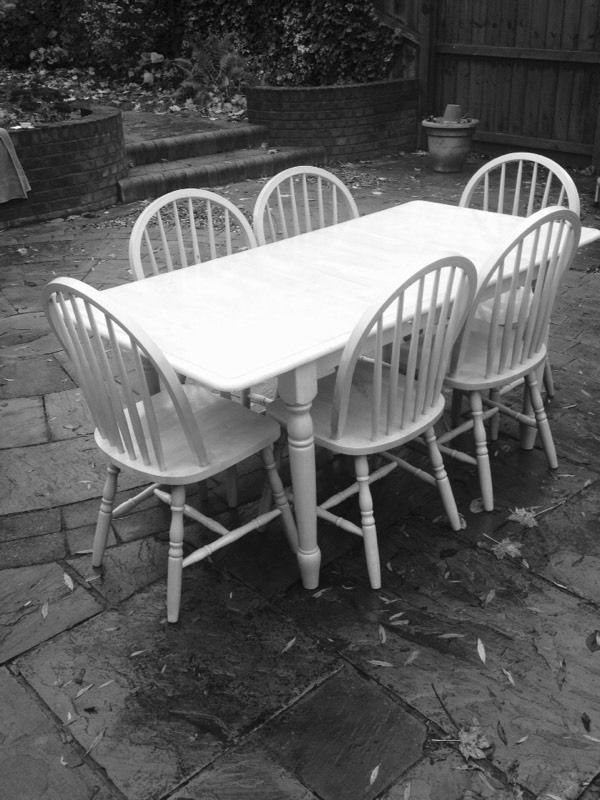 rubber wood extending table and 6 chairs in good condition just a