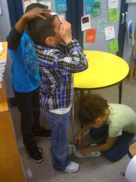 Measuring height with adding machine tape.