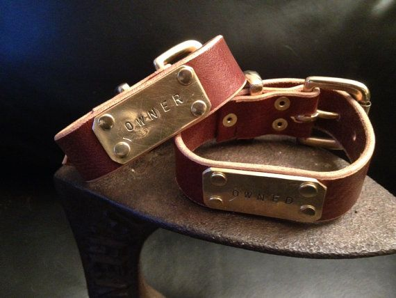 Paired leather and brass Owner and owned cuffs