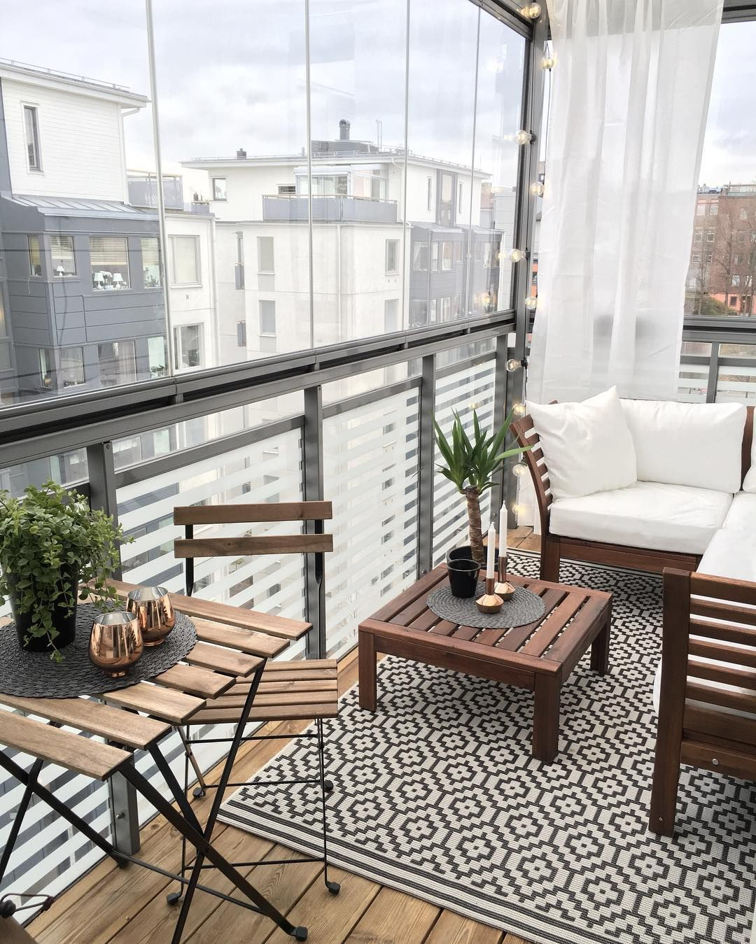 Just showing an outdoor rug on a balcony (not this particular rug, per se)  Beautiful and cozy apartment balcony decor ideas
