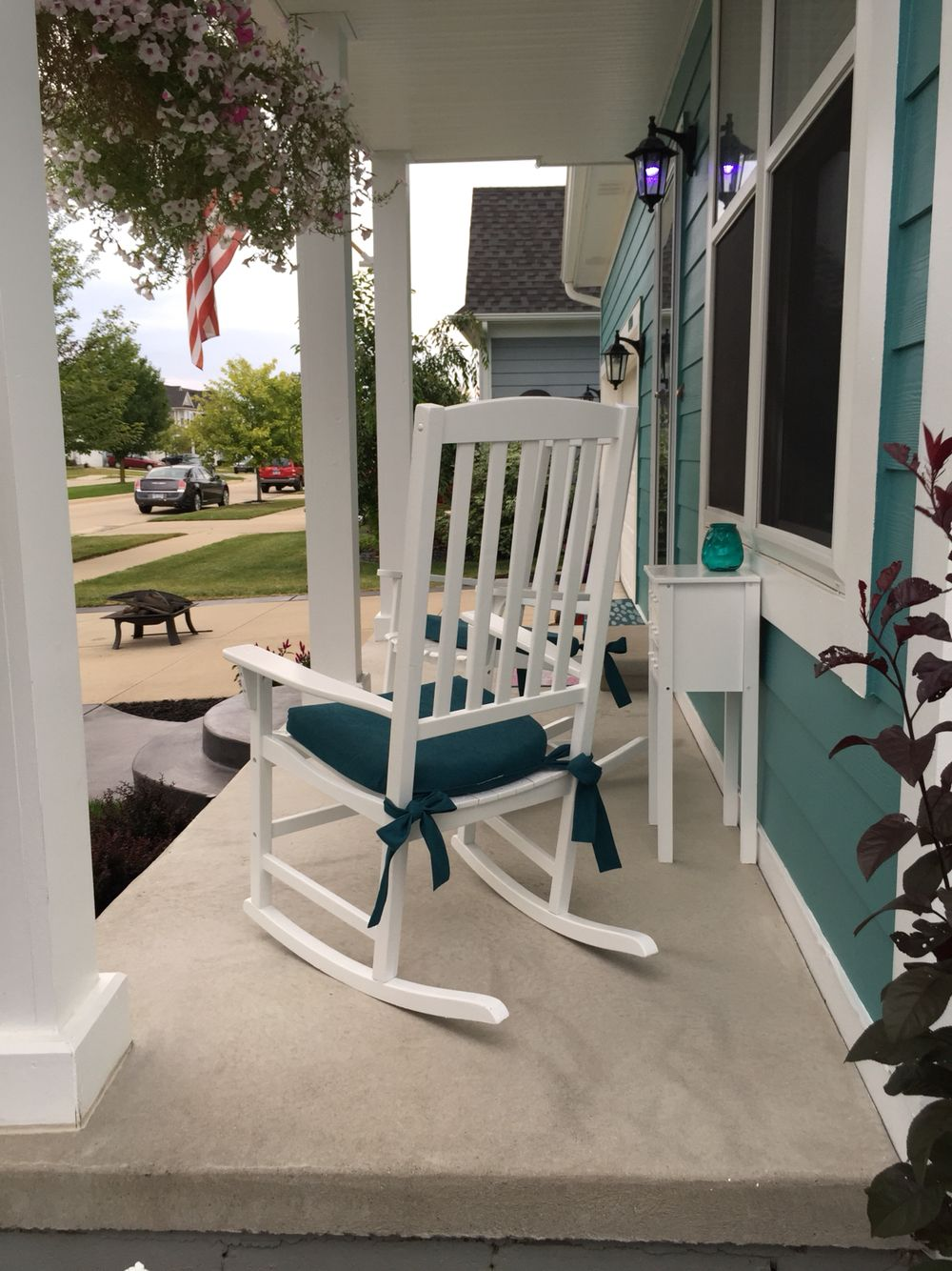 Refinished White Front Porch Rocking Chairs With Teal Cushions With Bow Ties