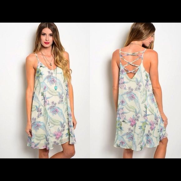BUTTER CREAM FLORAL CRISS CROSS BACK SUNDRESS NWOT and made by cals. It is done in a pale butter cream covered in pastel florals in pink,yellow, green and blue.  It is fully lined with a sheer floral overlay.  It is meant to hang loose on the body, the perfect summer dress!!  It has thin spaghetti straps and a semi open back with criss cross detail.  Small measures 34-36 inches in the chest, medium 36-38 or large 38-40 inches in the chest and the overall length is about 32 inches from…