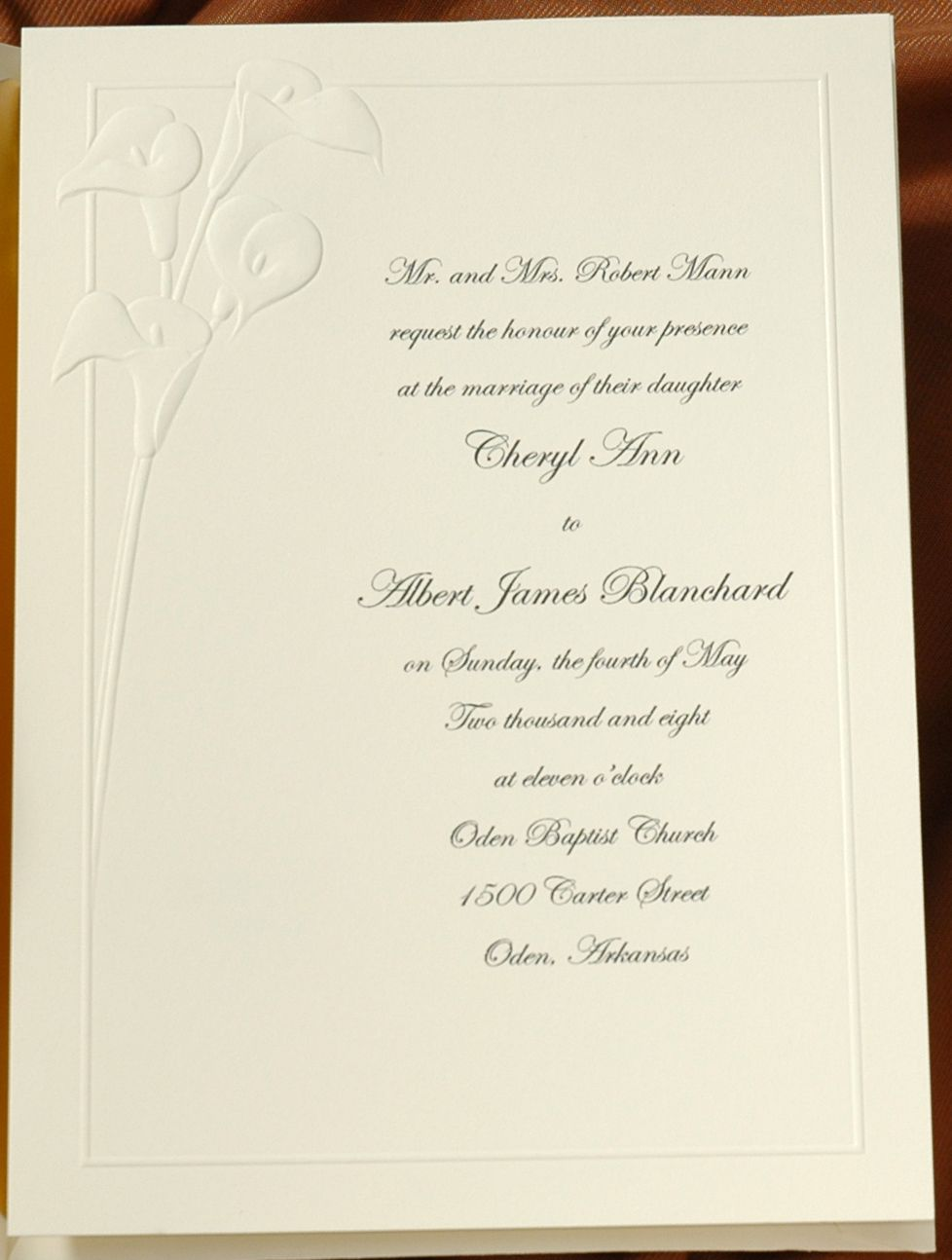 This invitation is classic grace with an embossed calla lily and a ...