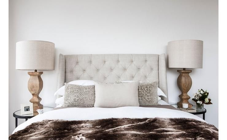 Earth Toned Bedroom Features A Light Grey Tufted Wingback Headboard On Bed Dressed In White And