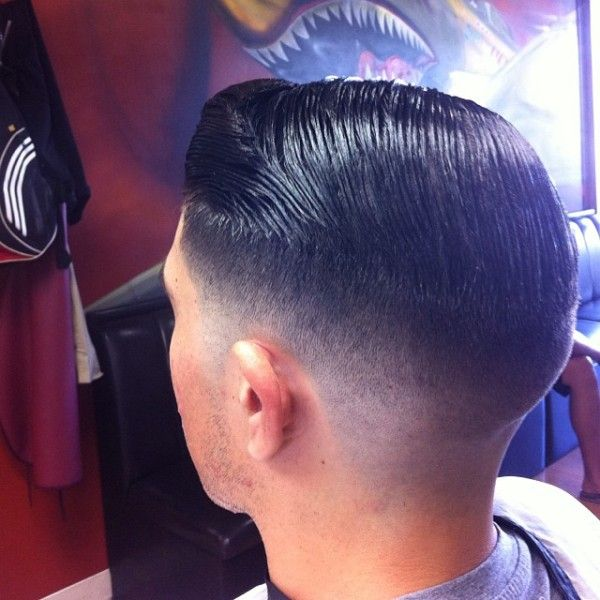 Low Zero fade with heavy graduated top lengths , liberal