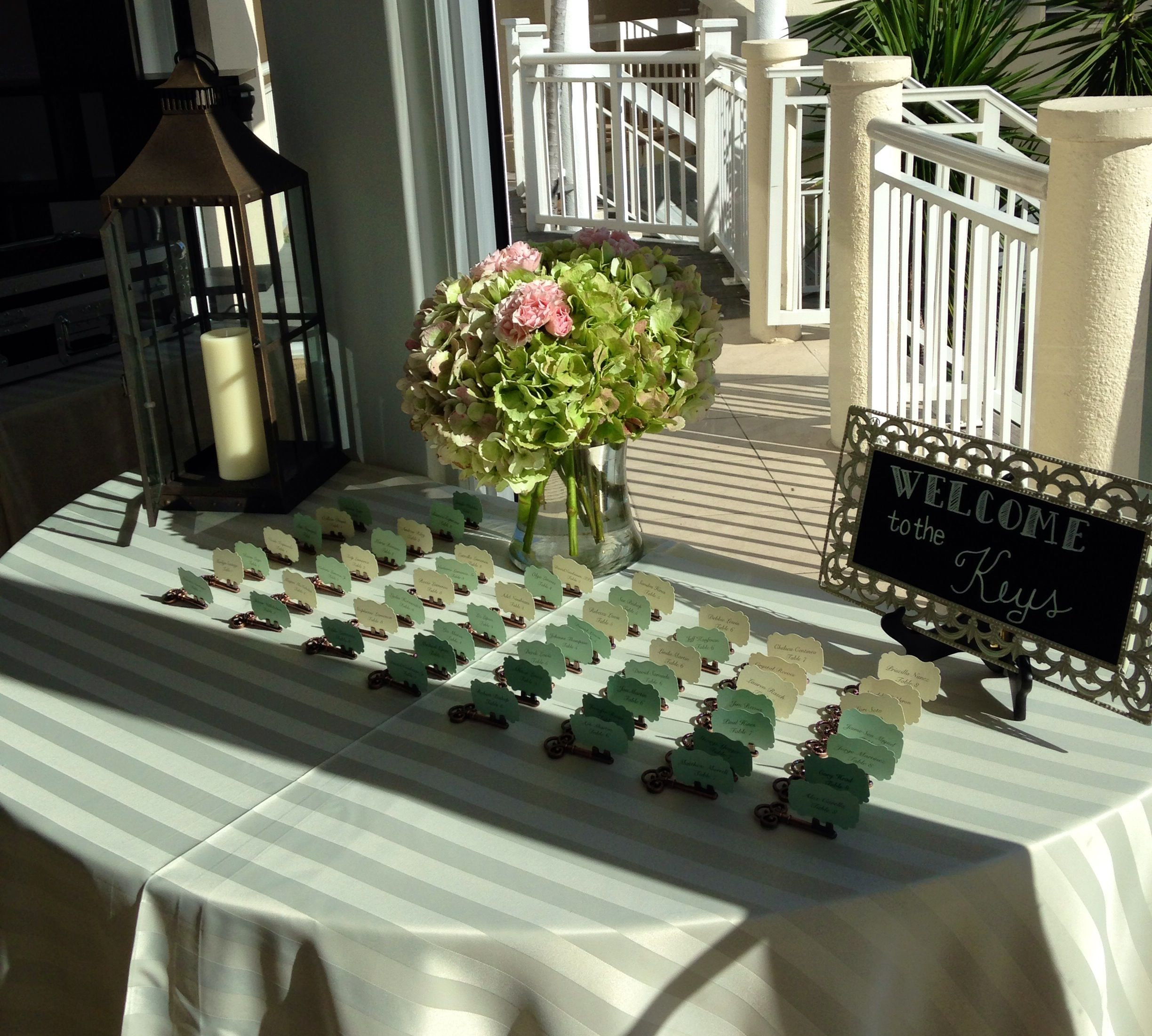 Lantern and Floral Welcome Table  at Hyatt Key West Resort & Spa by Love In Bloom Florist