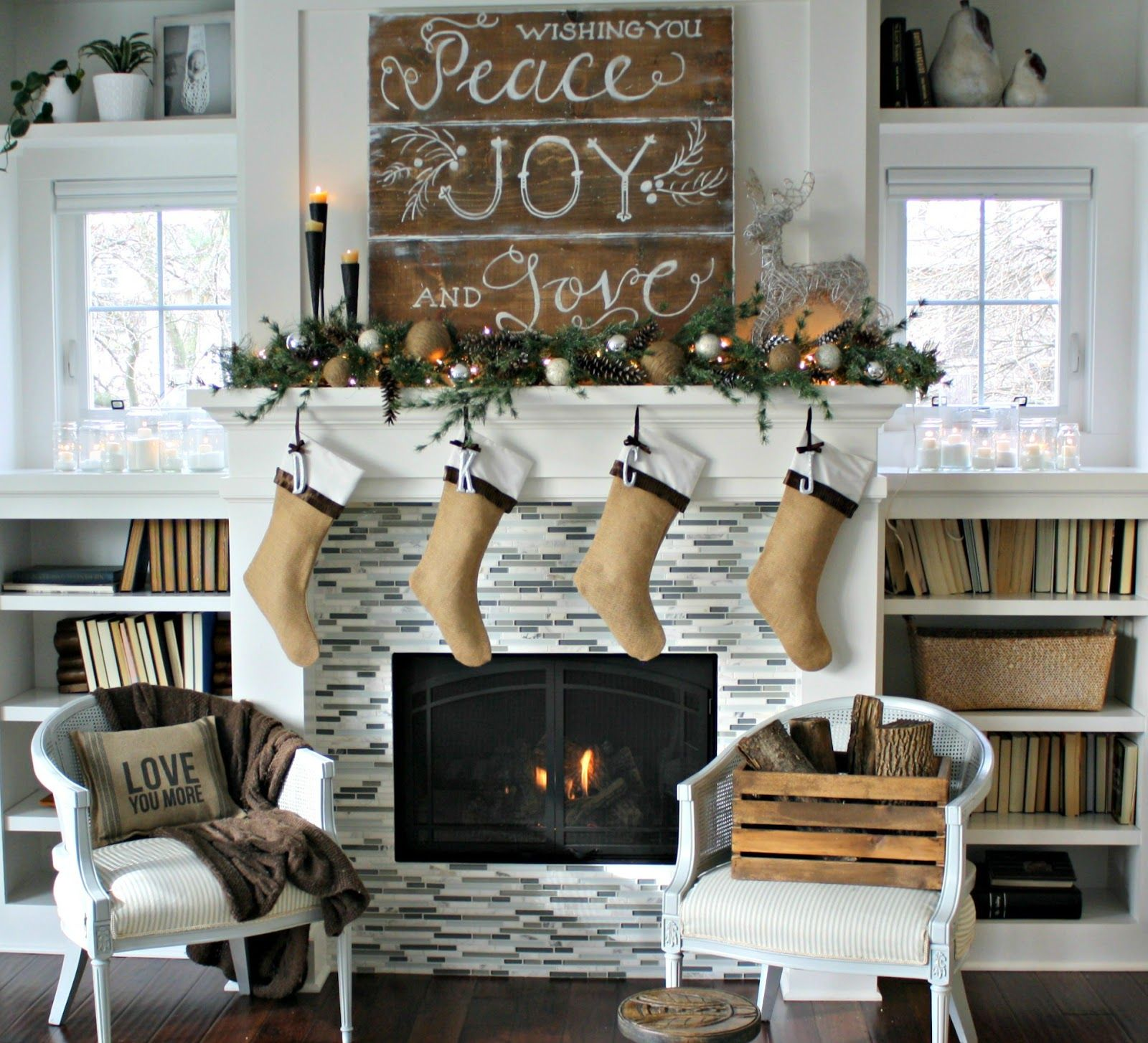 Country christmas mantel decor - Christmas Decor Mantle Decorated With Diy Rustic Painted Sign Candles Greenery Stockings