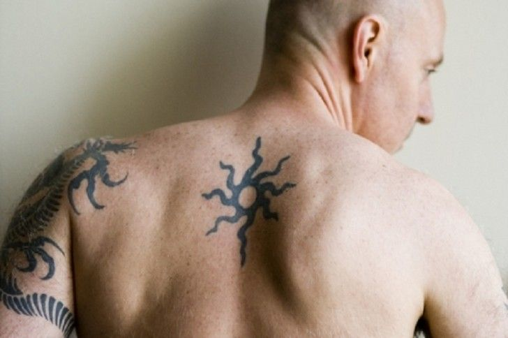 16 Back Tattoo Ideas For Men With Various Size Small Tribal Sun