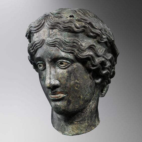 Greek bronze head of Dionysus, hellenistic period, 2nd-1st century B.C. Copper-tin alloy, silver-plated eyes, 23.8 cm high. Private collection