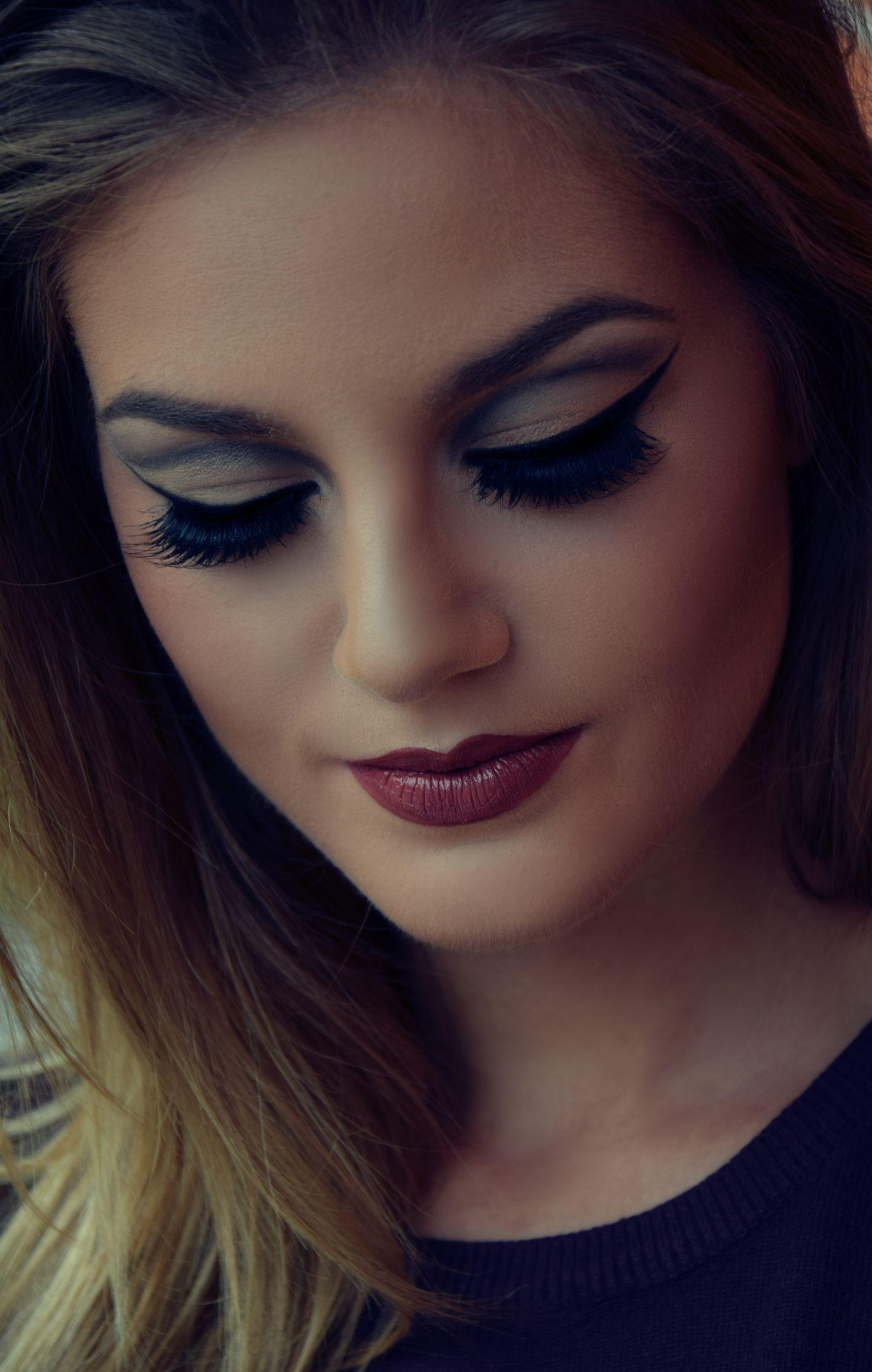 7744dfa9c94 Eyes are deeply shaded in grey and black tones. False eyelashes. She wears  MaxFactor Lipfinity lipstick. Foundation and mascara by Maybelline, eyeshad…