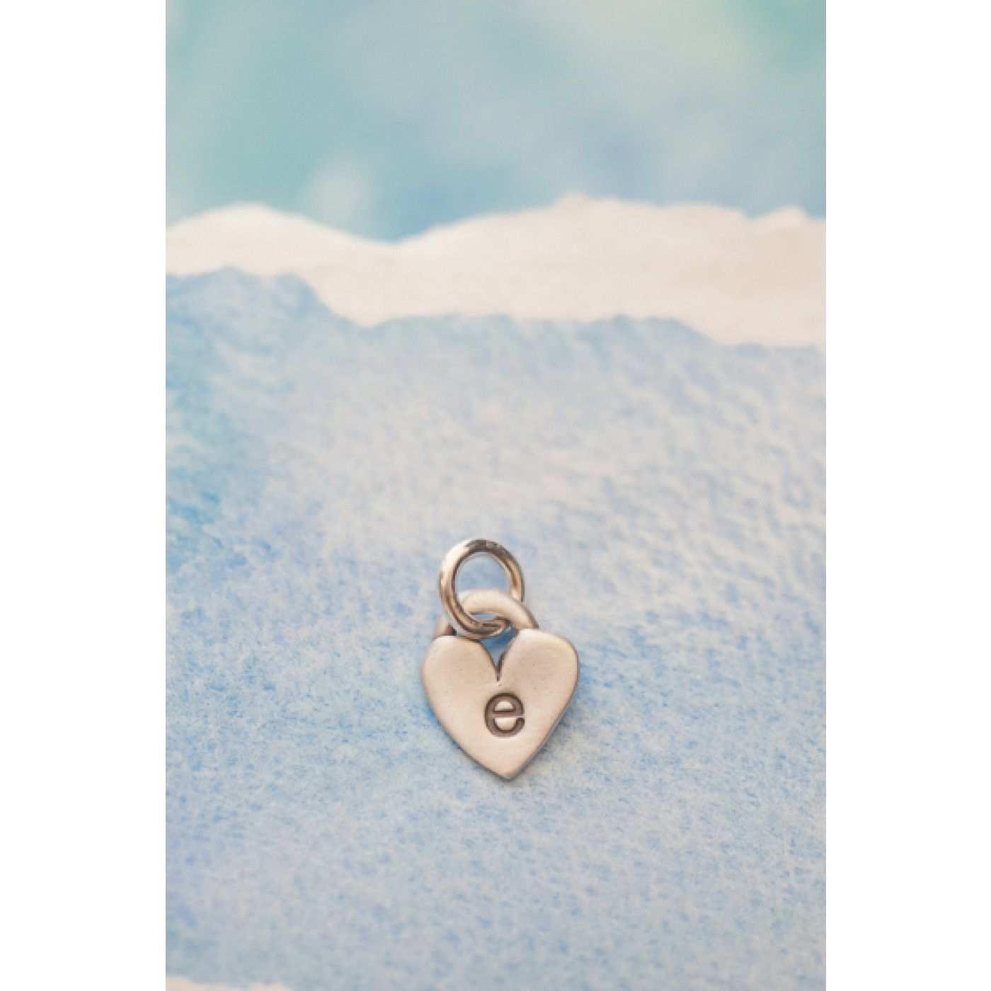 These beautiful sterling silver  hand-molded hearts are stamped with the initial of your choice, attached to a small sterling silver jumpring. It's absolutely darling and full of meaning!