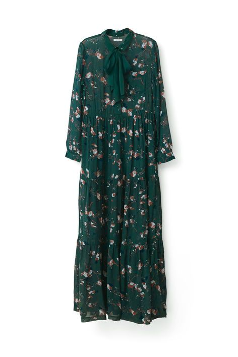 Beautiful flowering maxi dress, with a detachable  ribbon, long sleeves and a front pocket. The  dress has an oversized fit.