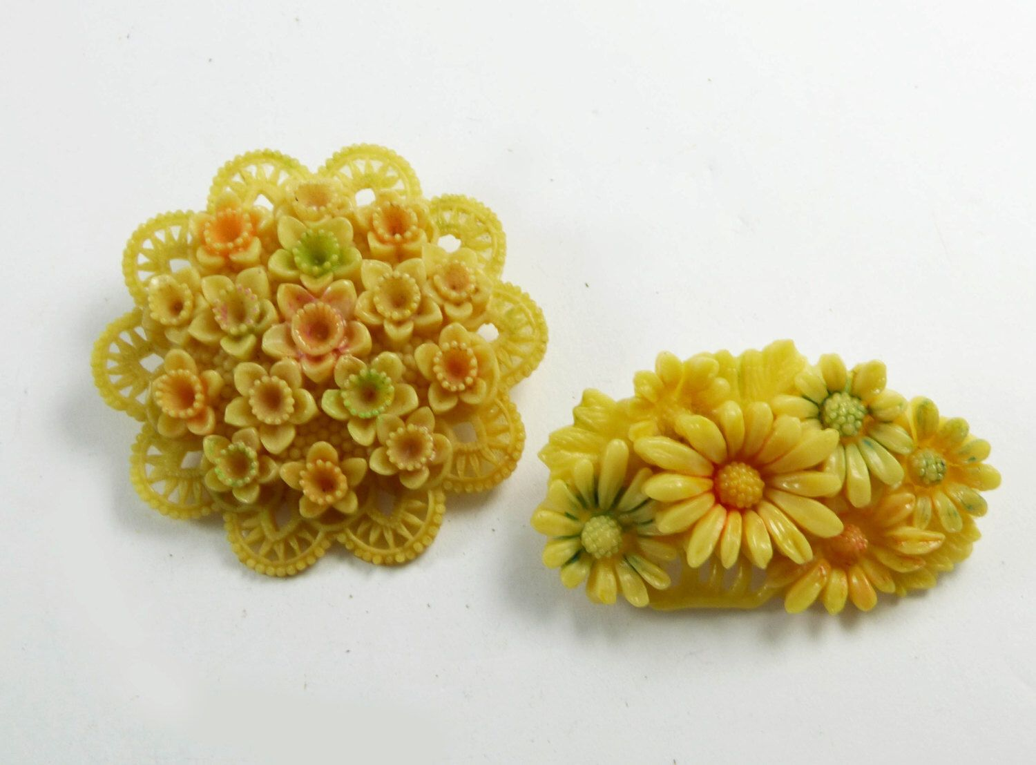 Celluloid Occupied Japan Carved Flower Brooch Pair by VintageLaneJewelry on Etsy https://www.etsy.com/listing/253161883/celluloid-occupied-japan-carved-flower
