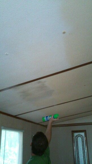 Cleaned nicotine stained ceiling by spraying with Scrubbing