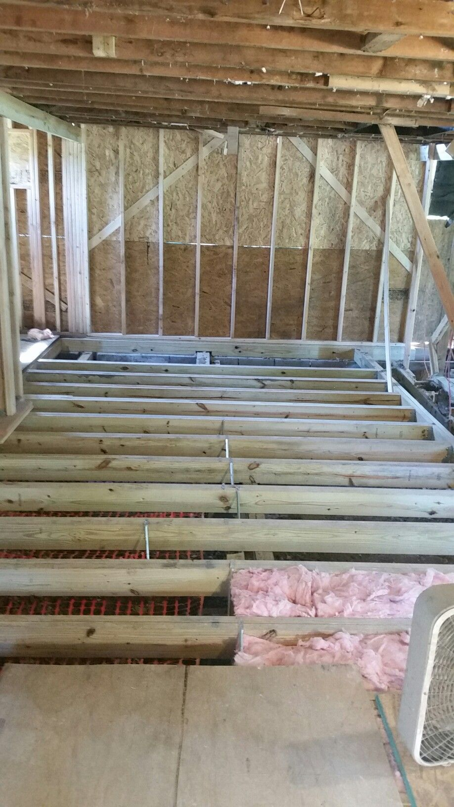 New Floor Joists And Walls In Back Part Of House Ready To Remove