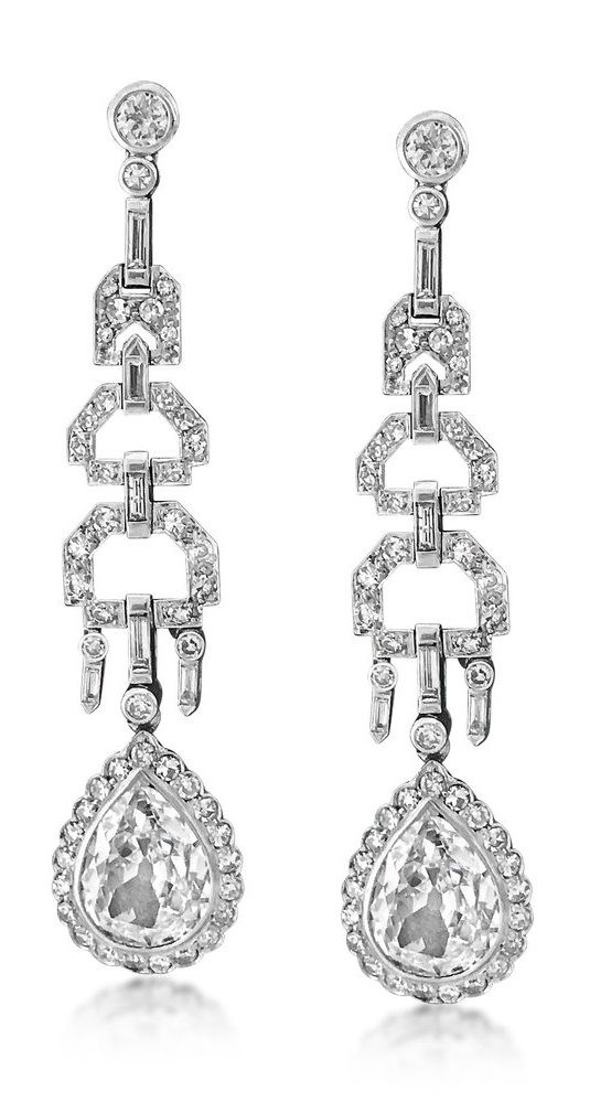 A pair of Art Deco diamond earrings, 1920s. Each set with a pear shaped diamond to single-, baguette- and old European-cut diamonds, mounted in platinum, 5.7 cm long. #ArtDeco