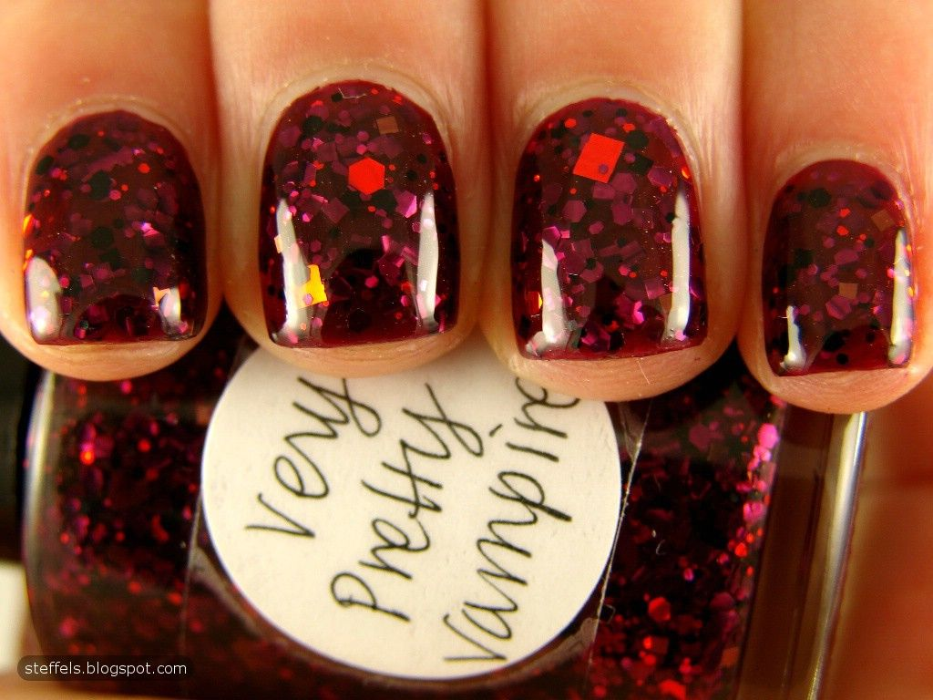 Make a statement this fall with a deep red glitter nail color ...
