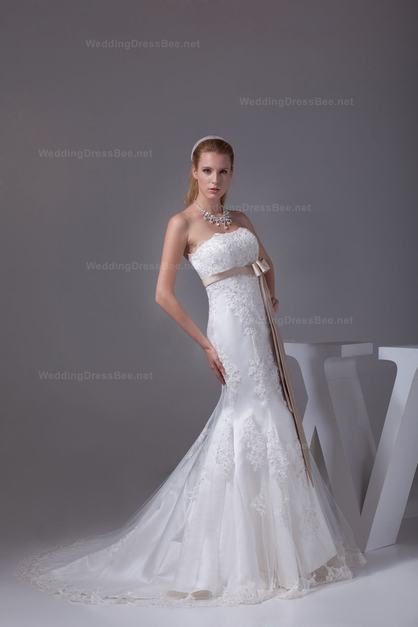 Attractive strapless trumpet style wedding dress with colored sash